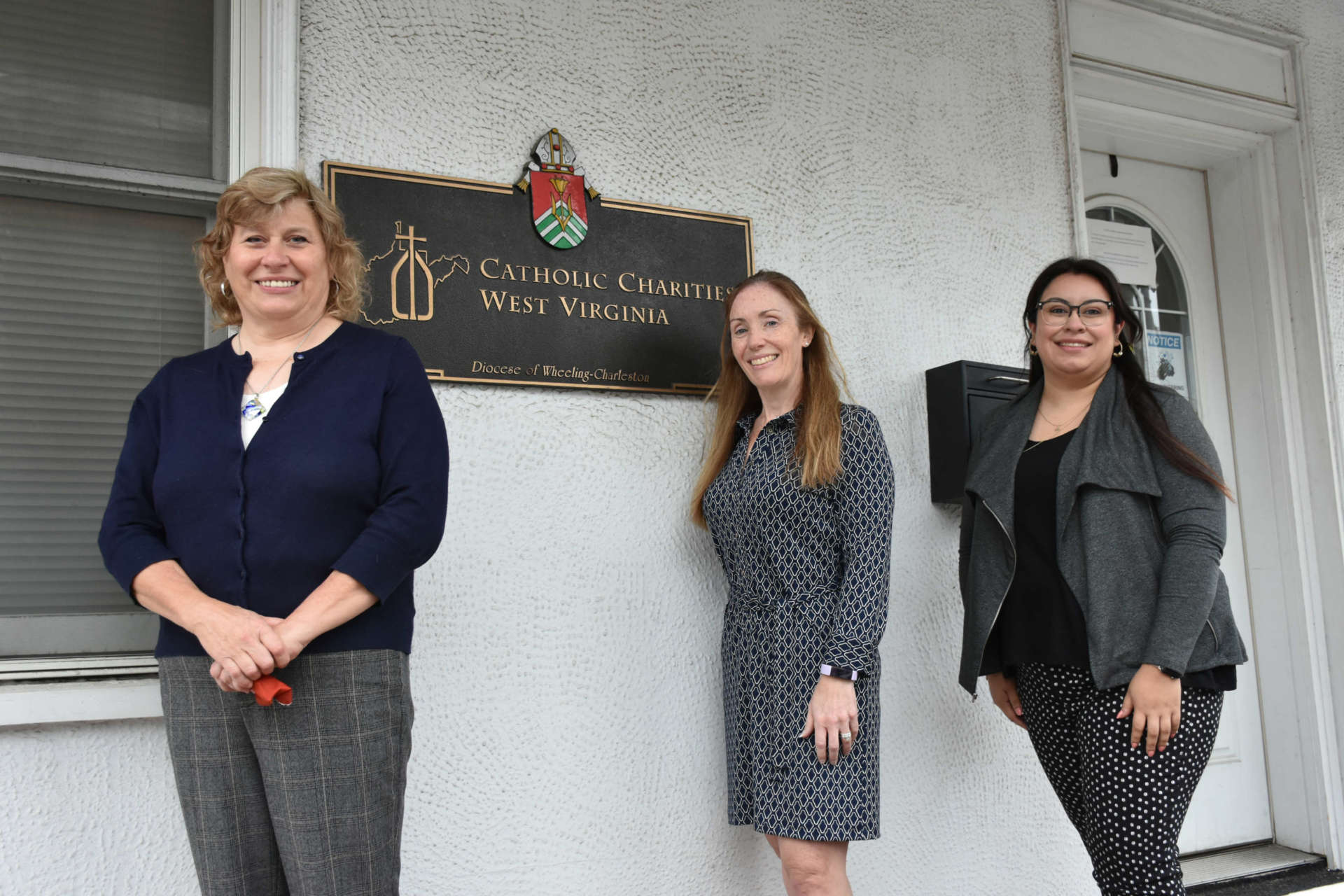Pictured (l. to r.) are Trina Bartlett, eastern regional director Catholic Charities West Virginia; Siobhan Bertone program assistant; and Luci Hernandez, case manager.