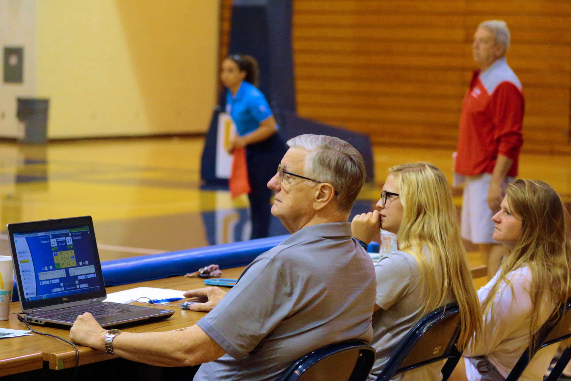 Phil Porterfield works the scorers' table at a Shepherd University Women's Volleyball match.