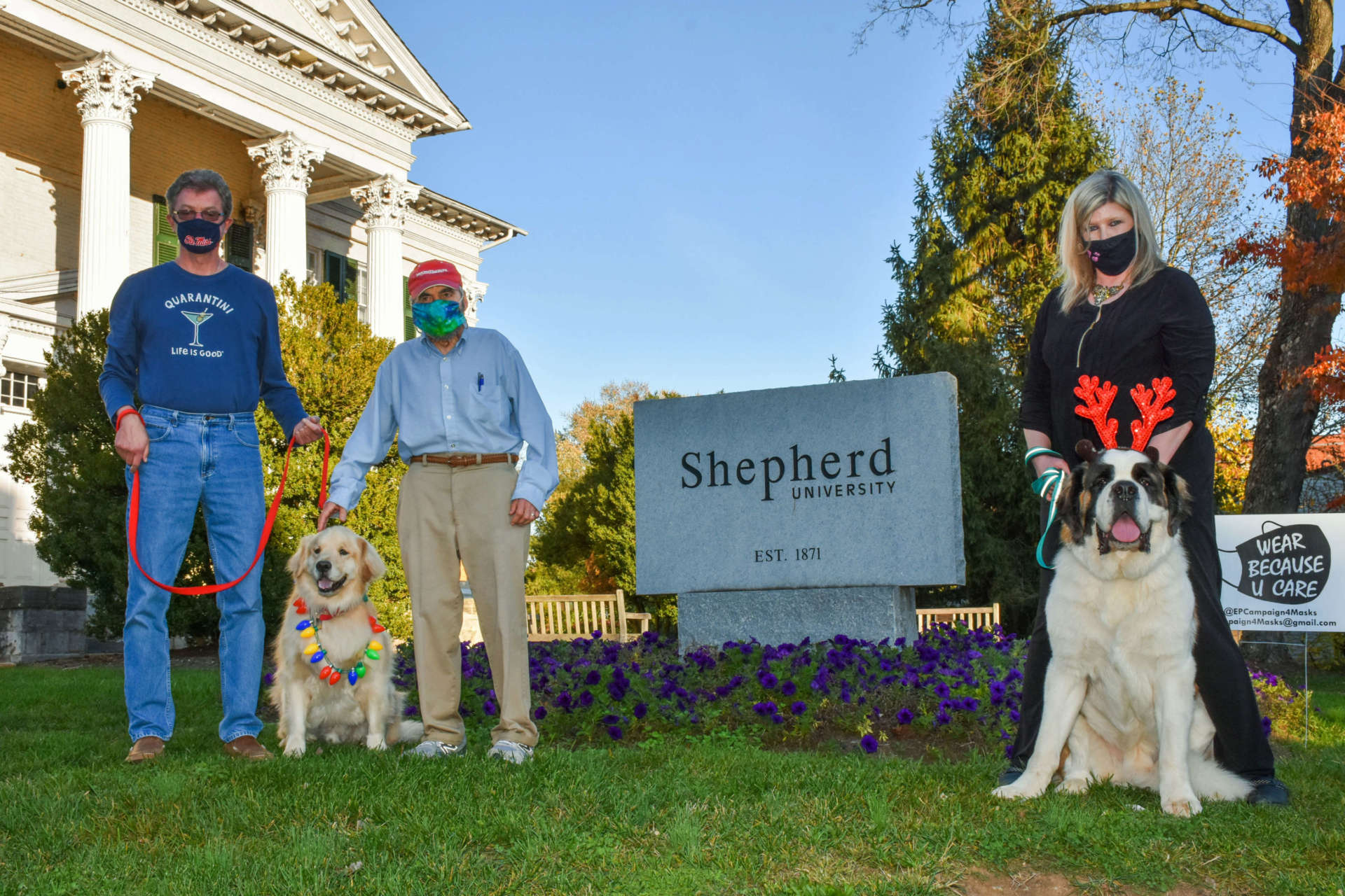 Pictured (l. to r.) are Paul Gerrard, community organizer, with Rufus; Jim Auxer, Shepherdstown mayor; and Amy Speck, university organizer, with Smoke.
