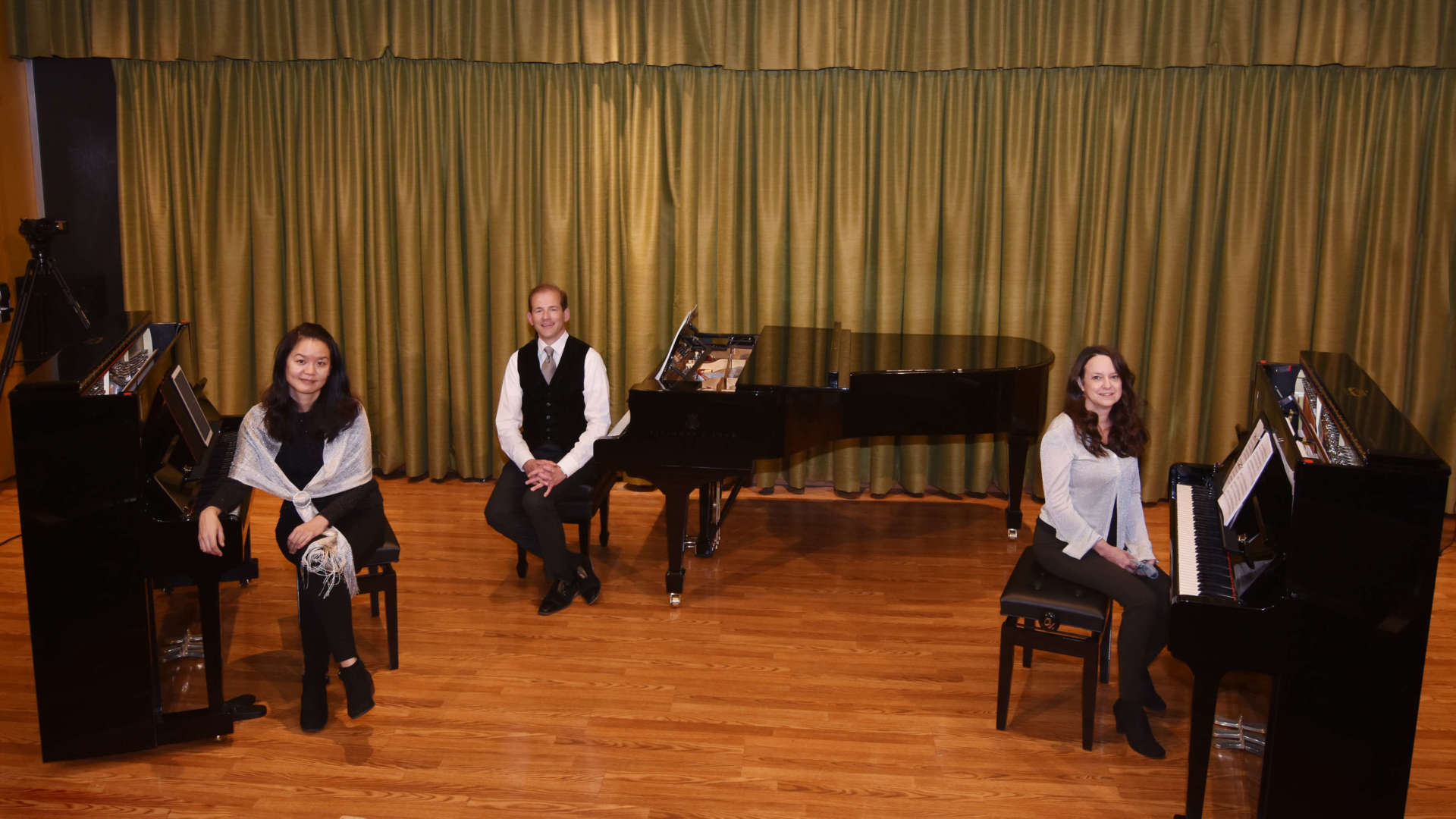 Pictured with new Steinway-designed Boston UP-126 Performance Edition pianos and a Steinway Model B Classic Grand Piano are (l. to r.) Dr. Yu-Hsuan Liao, director of keyboard studies, Dr. Scott Beard, provost, and Dr. Laura Renninger, dean, Center for Teaching and Learning.