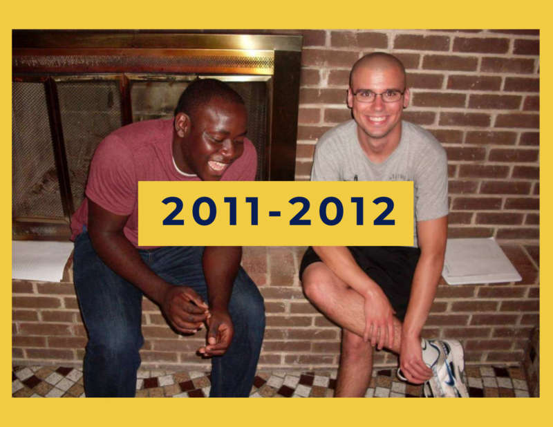 """yellow background, in the center is two students laughing in front of a fire place, and in the center reads """"2011-2012"""""""