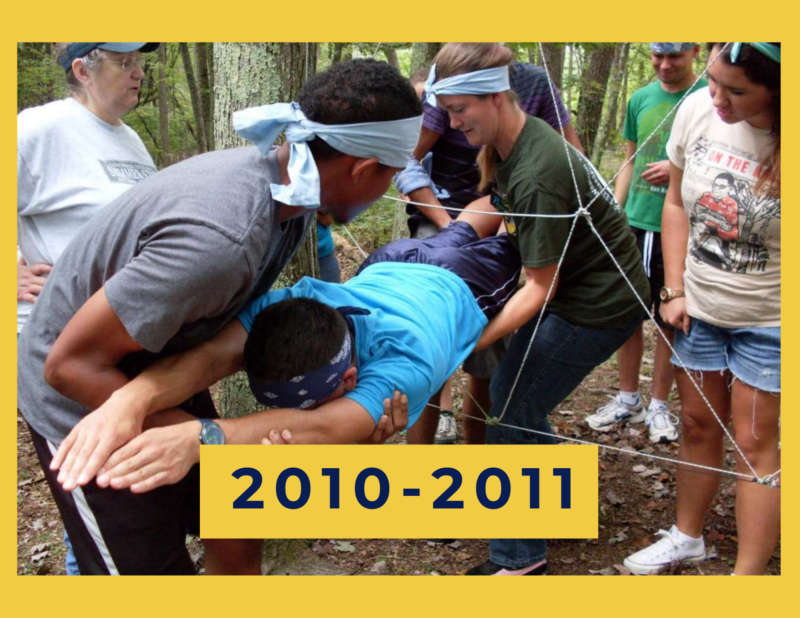 """yellow background, in the center is a group of students participating in the ropes course, in the bottom middle reads """"2010-2011"""""""
