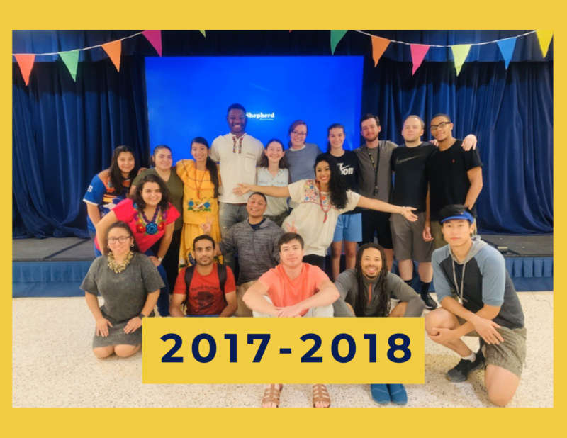 """yellow background, in the center is a group of students standing in front of a stage, and in the center middle reads """"2017-2018"""""""
