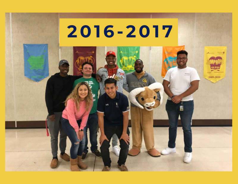 """yellow background, in the center is a group of students standing side by side in front of a wall with posters on it, and above in the center reads """"2016-2017"""""""