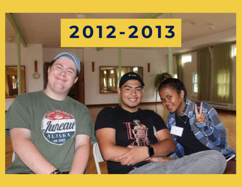 """yellow background, in the center of the image is three students posing for the camera, and in the top center reads """"2012-2013"""""""