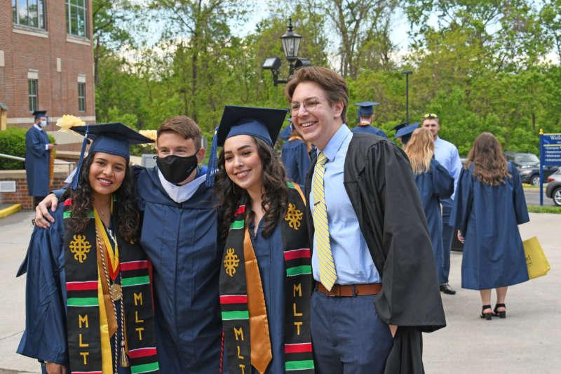 graduates and the msa advisor posing for a photo