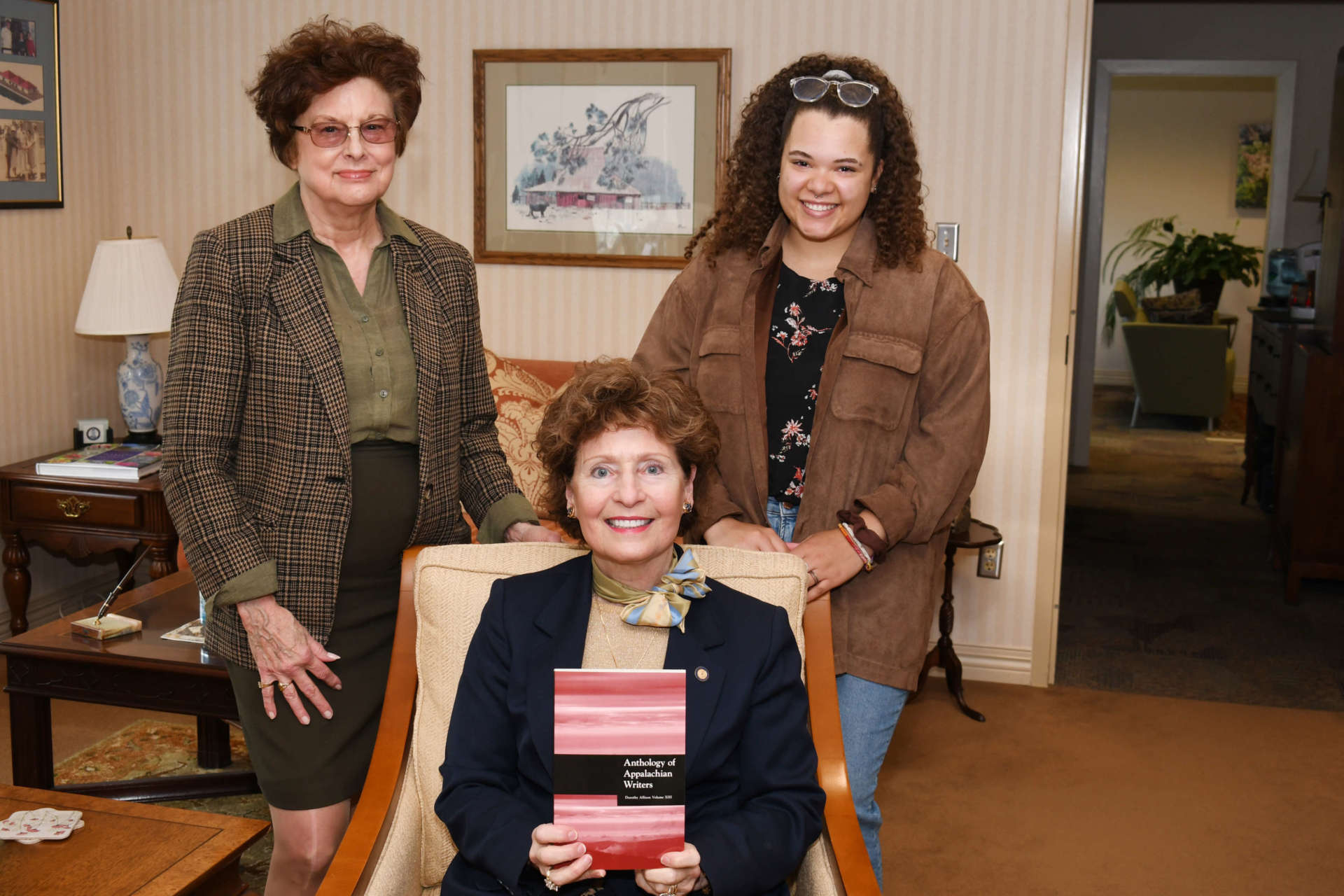 Pictured are (seated) Dr. Mary J.C. Hendrix, president, standing (l. to r.) Dr. Sylvia Baily Shurbutt, director, Center for Appalachian Studies and Communities, and Aneyla Dozier, English education major, Martinsburg, student editor of the Anthology.