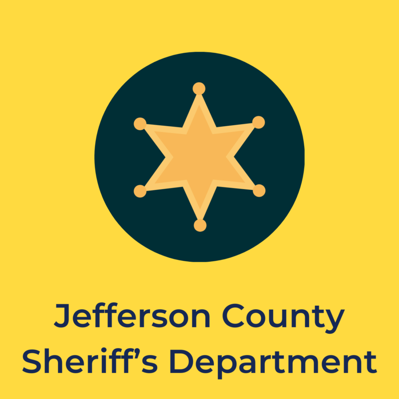 """yellow background, in the center is a sheriff's badge, below it reads """"jefferson county sheriff's department"""""""