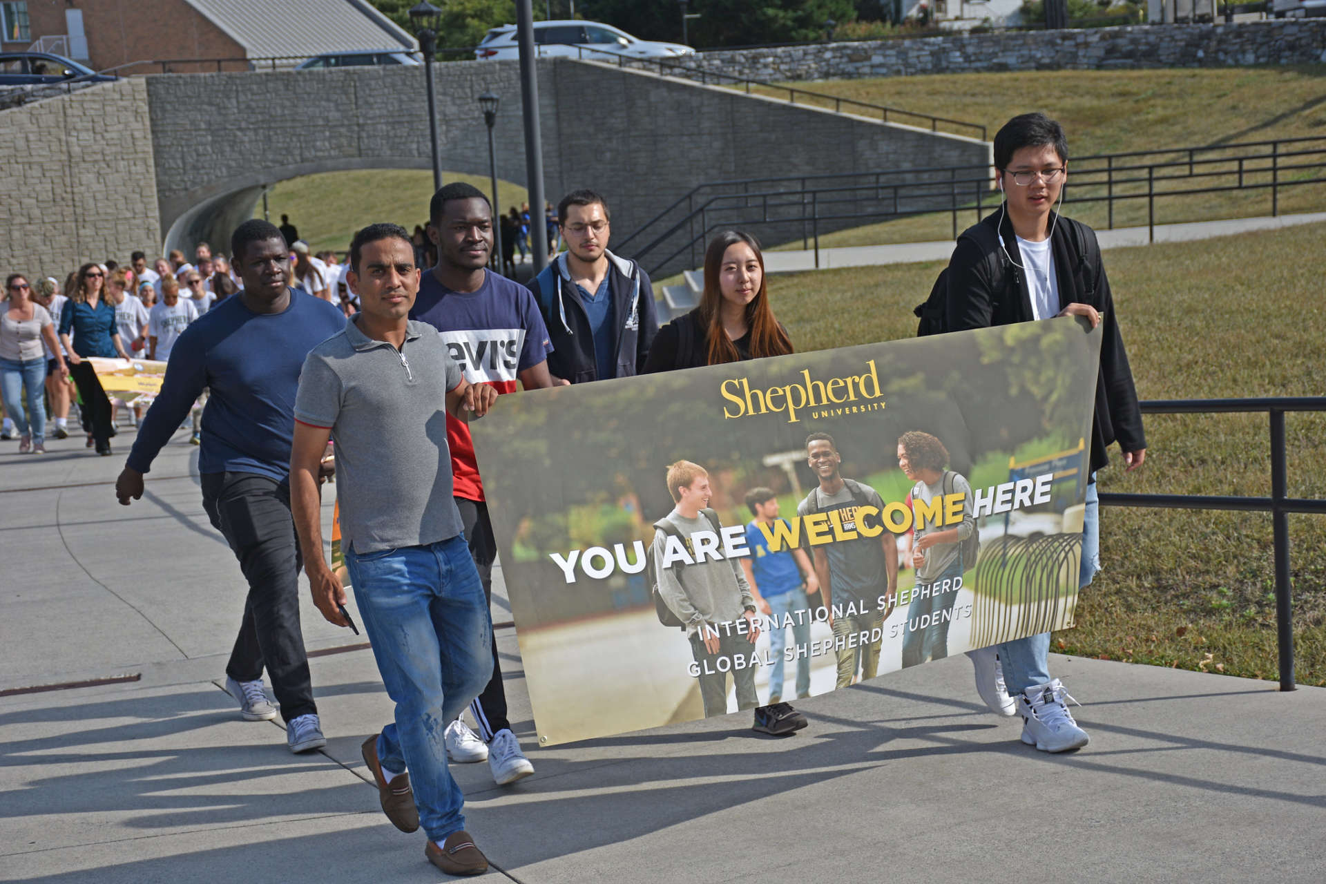 Students carry a banner during the 2019 Founders Day parade.