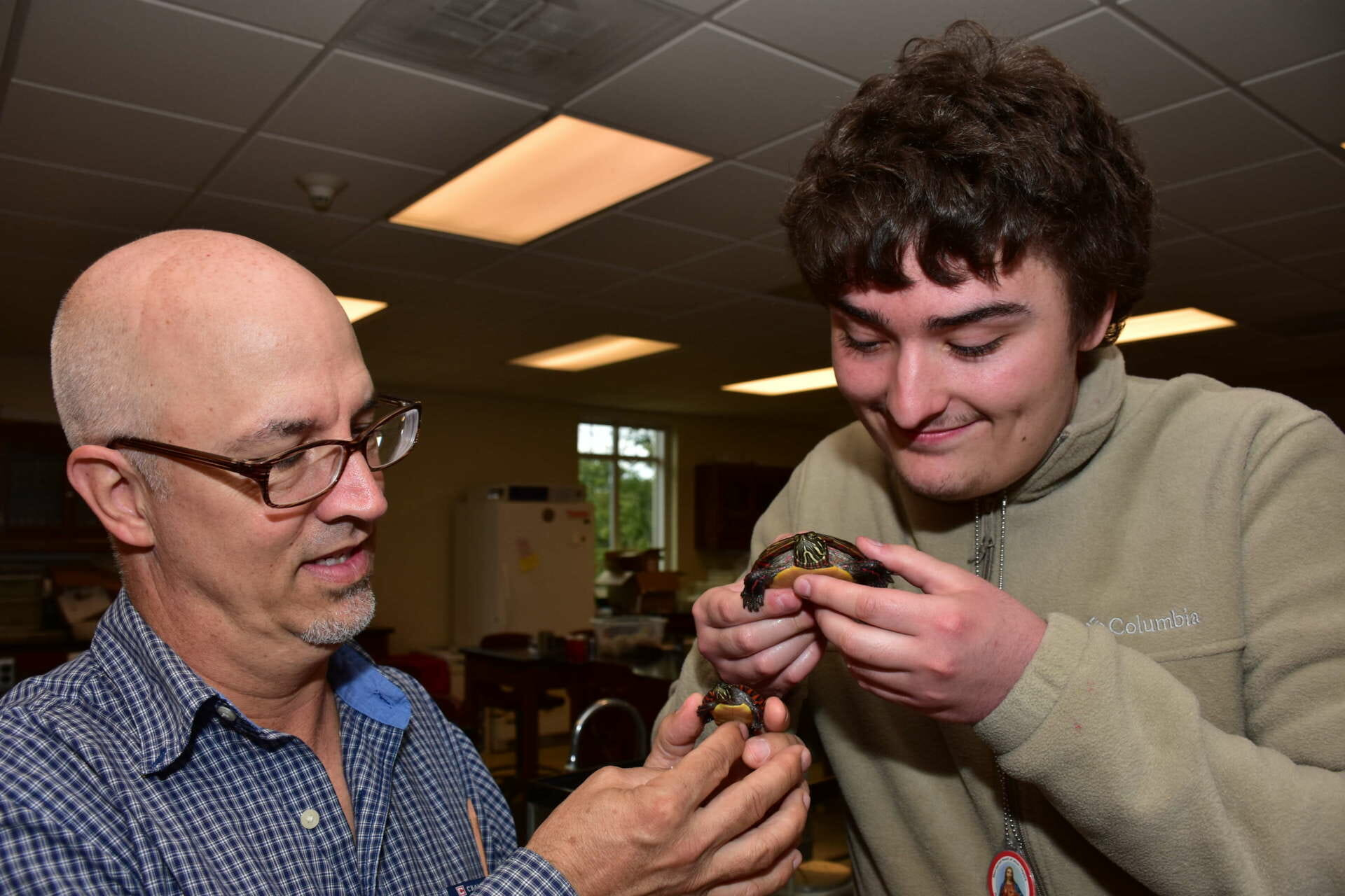 Dr. John Steffen (l.) and one of the students who helped with his painted turtle research, Rhett Quigley, a biology major from Martinsburg, examine painted turtles.