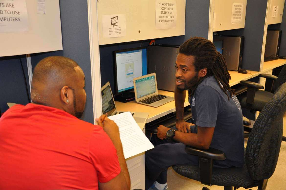 Students are  working on coursework in the Center for Teaching and Learning.