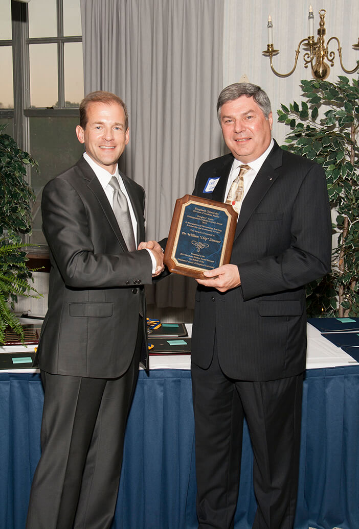 "Dr. Scott Beard presented the graduate faculty award to Dr. William ""Chip"" Zimmer."
