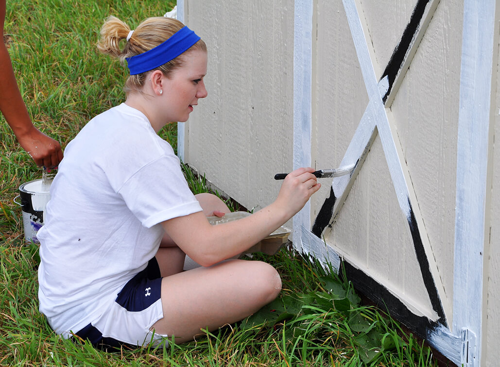 Heather Phares helped paint a shed in a pasture at Horses With Hearts.